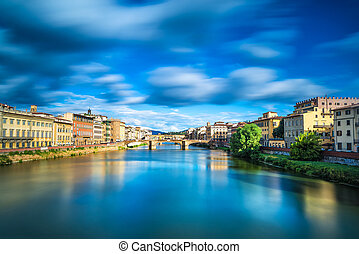 Santa Trinita and Old Bridge on Arno river, sunset landscape. Florence or Firenze, Italy.