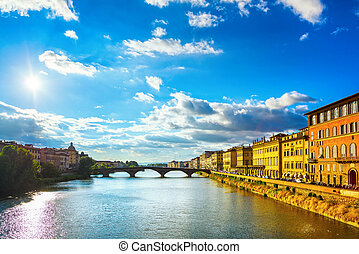 Santa Trinita Bridge on Arno river, sunset landscape. Florence, Italy
