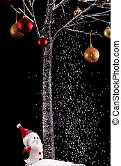 Santa under a tree with snow on black background