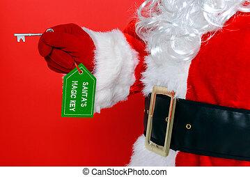 Santa Claus or Father Christmas holding his magic key