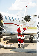 Santa Using Waving Against Private Jet