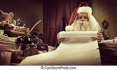Santa Claus reading a very long Christmas list and looking at camera.