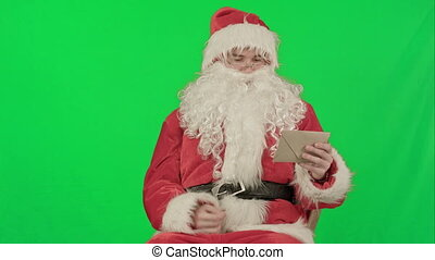Santa with Christmas letter or wish list on a Green Screen Chrome Key