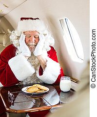 Santa With Cookies And Milk Sleeping In Private Jet