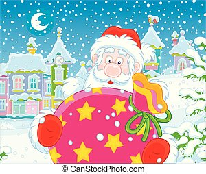 Santa with gifts on a snowy winter evening