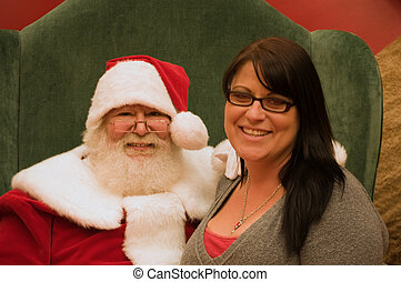 Santa with woman - Live Kris Kringle with young pretty adult...