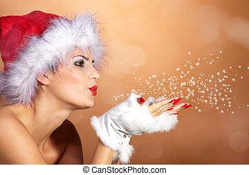 Santa woman blowing stardust