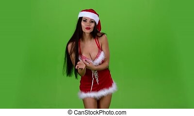 Santa woman dances sexual movements and sends an air kiss. Green screen. Slow motion