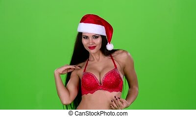 Santa woman flirting with men in a new year costume. Green screen