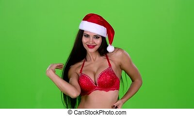 Santa woman flirting with men in a new year costume. Green screen. Slow motion