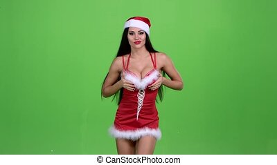 Santa woman goes in an erotic costume. Green screen. Slow...