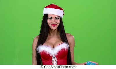 Santa woman holds a map in her hand and shows a thumb up. Green screen. Slow motion