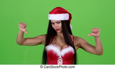 Santa woman in suit shows thumbs down. Green screen