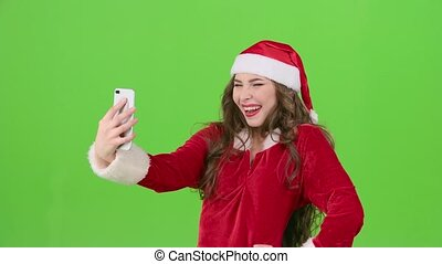 Santa woman makes the new years self with different emotions. Green screen
