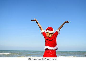 Santa woman on the beach.