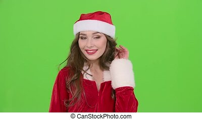 Santa woman sends an air kiss. Green screen. Close up