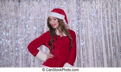 Santa woman winks at her friend. Bokeh background - Santa...