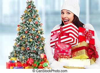 Santa woman with Christmas gift.