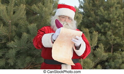 Santa writing letter - Pensive Santa Claus writing a letter...