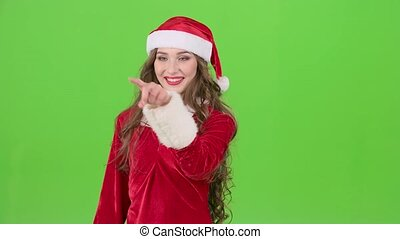 Santas assistant draws an airy congratulation on the new year. Green screen