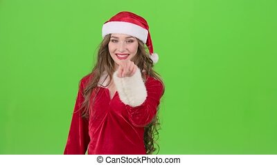 Santas assistant draws an airy congratulation on the new year. Green screen. Slow motion