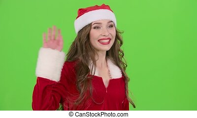 Santas assistant flirts and waves her hand to her boyfriend....