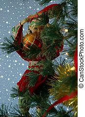 Santa's Elf Decorating the Christmas Tree
