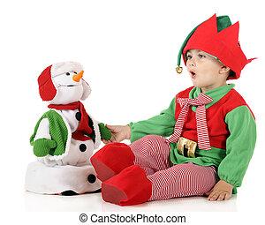 Santa's Elf Testing Toy Snowman