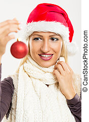 Santas Girl Holding A Christmas Decoration