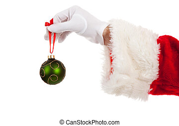 Santa's hand holding a green Christmas ornament