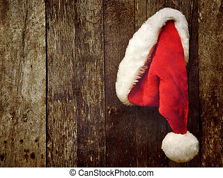 Santa's hat hanging on wood.