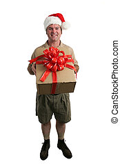A full view of a delivery man with a Santa hat delivering a gift - isolated