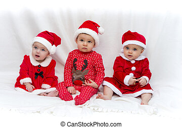 Santas Little Helpers - Three Babies Dressed in Christmas...