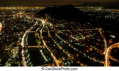 Santiago de Chile city night time lapse with highway and San...