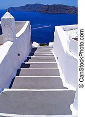 Santorini views - Classic white staircase towards the sea at...