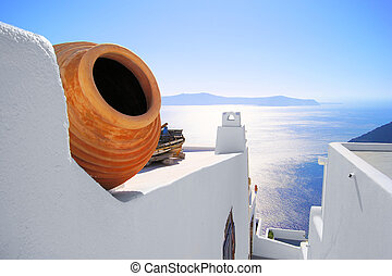Santorini views - View out to sea over the white walls of...
