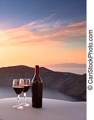 Santorini Wine - Wine bottle and glasses overlooking...