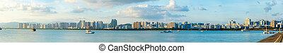 Sanya town evening cityscape, view from Phoenix island on Hainan Island of China