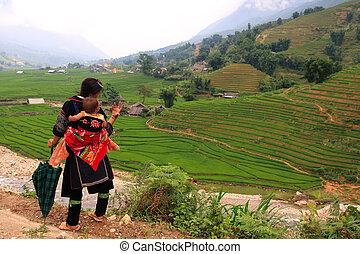 Sapa hill tribe woman and baby - Traditionally dressed Sapa...