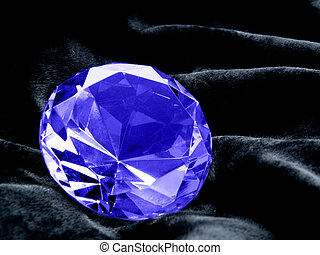 A close up on a Sapphire jewel on a dark background. Shallow DOF.