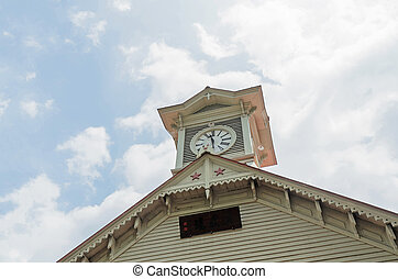 Sapporo city clock tower and blue sky in summer at hokkaido japan