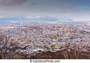 Sapporo, Japan winter skyline view from the mountains at ...