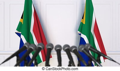 SAR official press conference. Flags of South Africa and...