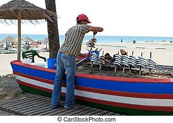 Sardine BBQ boat, Estepona, Spain. - Sardines being...