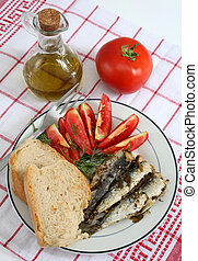 sardines bread and tomato vertical - A meal of sardines,...