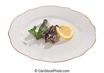 sardines in oil on a plate with lemon