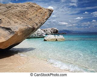 Sardinia beach - Big rocks and emerald water at Cala...