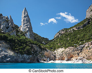 Aguglia pinnacle famous for rock climbing on the deserted Cala Goloritze beach, only accessible by boat, in the Gulf of Orosei (Golfo di Orosei) in Sardinia, Italy.
