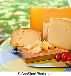 Sardinian cheese - Pecorino sardo cheese slices on wooden...