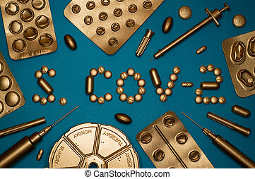 sars cov 2 word and blister packs on blue background